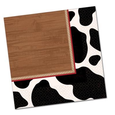 Papierservietten mit schwarz-weißem Kuhfell Flecken und Holz Motiv.